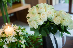 Candle and Wedding bouquet of white roses Stock Photos