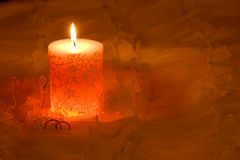 Candle and wedding rings. Darken composition with candle and two wedding rings. Copy space stock photography