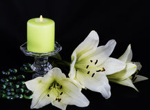 Candle and white lilies Royalty Free Stock Images