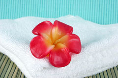 Candle on a white towel Royalty Free Stock Photo