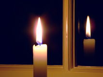 Candle by the Window Royalty Free Stock Images