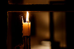 Candle in a window Royalty Free Stock Image