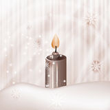 Candle on winter background Stock Image