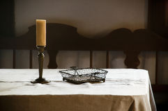Candle and wire bowl Royalty Free Stock Images