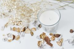 Free Candle With Floral Decor On A White Table. Cozy And Hygge Background Royalty Free Stock Images - 160974779