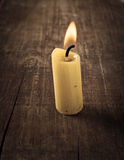 Candle on wooden background Royalty Free Stock Images