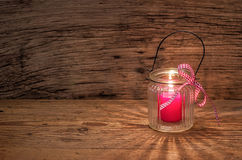 Candle on a wooden background Stock Images