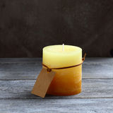 Candle on wooden boards Stock Images