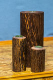 Candle in a wooden candlestick on a romantic background Royalty Free Stock Photo