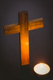 Candle and wooden cross Stock Photo