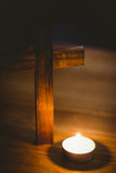 Candle and wooden cross Royalty Free Stock Photography