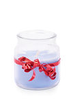 Candle wrapped in red ribbon Stock Photos