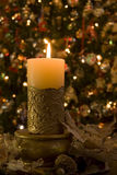 Candle and Wreath. Selective focus on candle with wreath infront of Christmas Tree Royalty Free Stock Photos