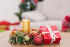 Candle and wreath on table for christmas Royalty Free Stock Photo