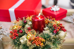 Candle and wreath on table for christmas Royalty Free Stock Images