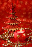 Candle and xmas tree Royalty Free Stock Photo