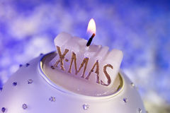 Candle with Xmas writing Stock Images