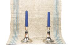 Candleholder on linen. Colorful and crisp image of candleholder on linen royalty free stock photography