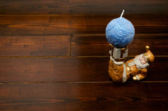 Candleholder in a shape of Santa Claus. With blue ball-shaped candle stock photo