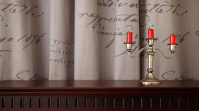 Candleholder and three red candles Stock Photos