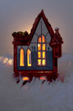 The candlehouse. The clay house with a candle inside between winter decorations Royalty Free Stock Images