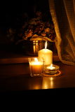Candlelight. Candle lights with a bunch of flowers in the dark interior Royalty Free Stock Photo