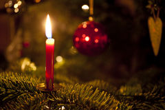 Candlelight. Close up of a candle on a christmas tree Stock Photography