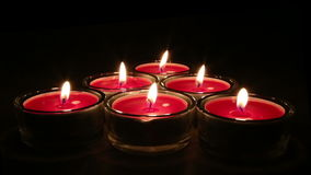 Candlelight against dark background stock video footage