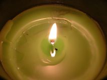 Candlelight. Apple scented candle flickering.  Creating a warm  glow Royalty Free Stock Image