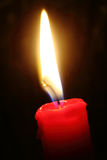 Candlelight on black isolated close up Royalty Free Stock Photos
