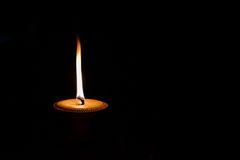 Candlelight. Candle light shines in the darkness Royalty Free Stock Image