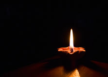 Candlelight. The candle to light in the darkness Stock Image
