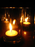 Candlelight - candlenight. The lighting of candles many leaves in a glass Stock Images