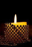 Candlelight Candles. Two Christmas Candles. Red candles with bright glowing flames on a black background Stock Photo
