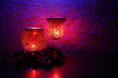 Candlelight Celebration. Red mosaic glass candle holders on a mantle Royalty Free Stock Images