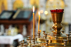 Candlelight in christian temple. Candles on candlestick during wedding ceremony in orthodox christian temple Stock Photo