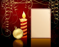 Candlelight and Christmas ball Royalty Free Stock Images