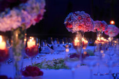 Candlelight dinner. Flowers to decorate the table,Romantic night,The reception,At the scene of the dinner Royalty Free Stock Photos