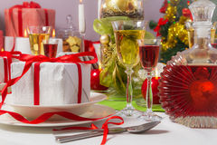 Candlelight and gifts all around the Christmas table Stock Image