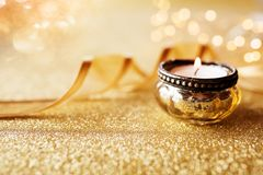 Candlelight on golden glittering background Royalty Free Stock Photography