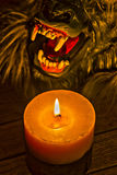 Candlelight illuminating the werewolf face HDR effect royalty free stock photo