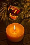 Candlelight illuminating the werewolf face HDR effect. The two-toned candlelight illuminating the werewolf face close up HDR effect Royalty Free Stock Photo