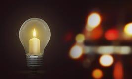 Candlelight on light bulb illuminate the dark room Royalty Free Stock Photo