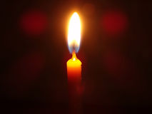 Candlelight. Light a candle in the dark bruise Royalty Free Stock Photography
