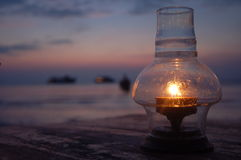 Candlelight. The magic moment of sunset provided the perfect scenario for a romantic candlelight dinner by the sea royalty free stock photography