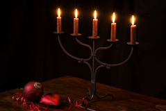 Candlelight with Ornament. Candle holder with Christmas Ornament on wooden table with black background Stock Photography