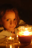 Candlelight portrait of beautiful little girl Royalty Free Stock Photography