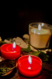 Candlelight. With rose leaves on dark background Stock Photo