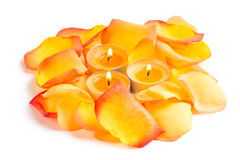 Candlelight and rose petals in orange color Stock Photo