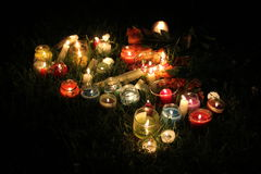 Candlelight. A summer candlelight vigil in the grass Royalty Free Stock Photo